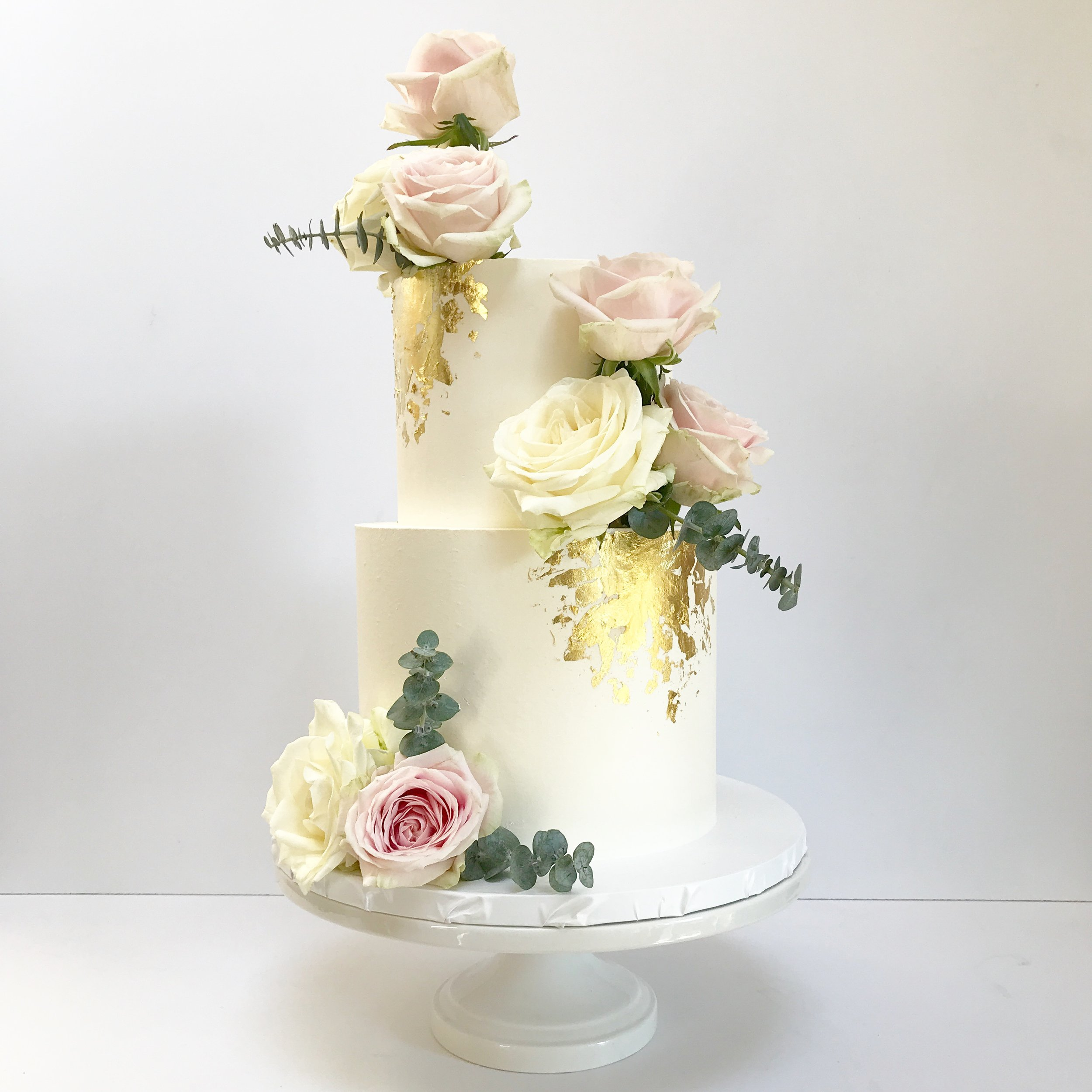 White two tier buttercream cake with gold leaf and vintage roses.JPG