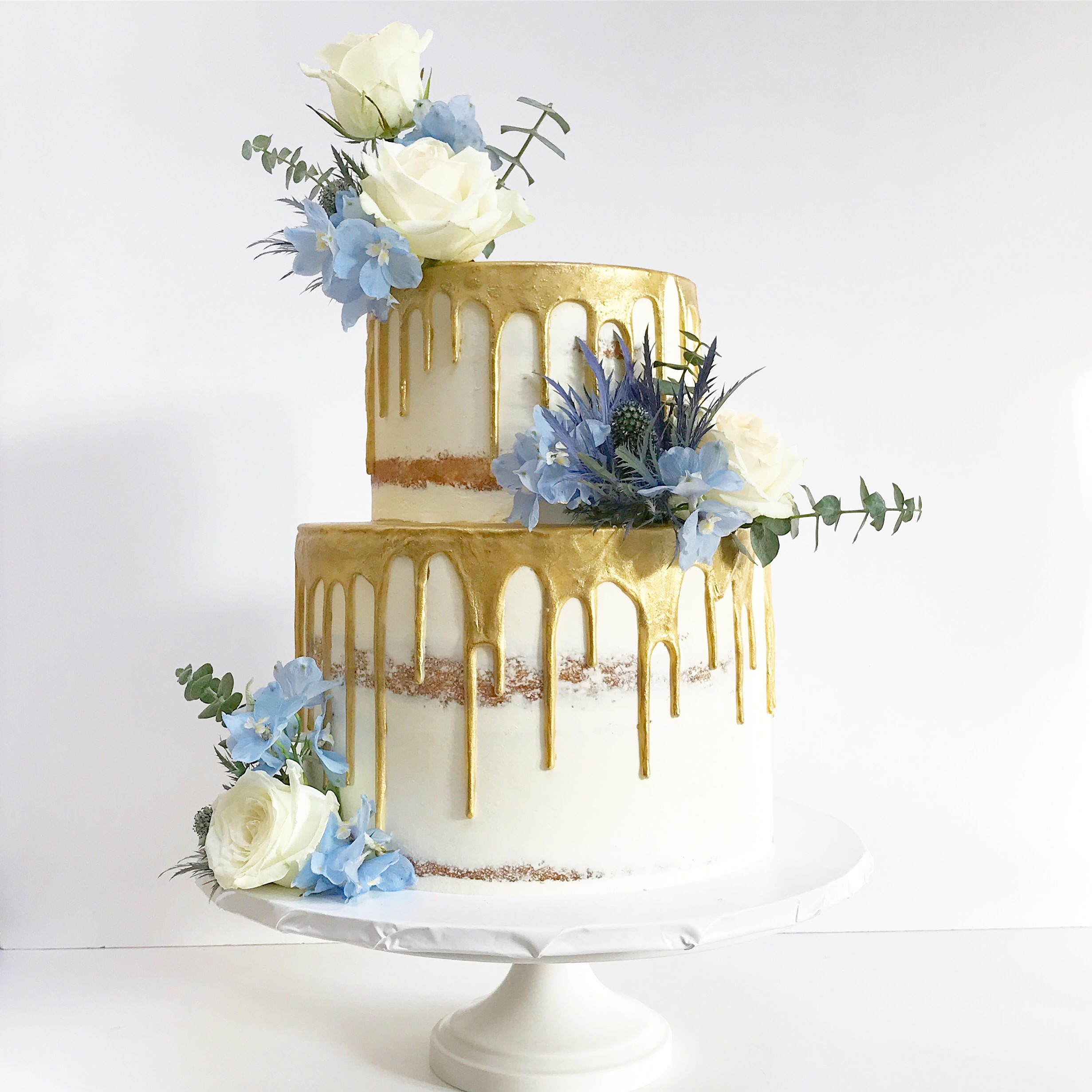 Semi-naked two tier baby shower cake.jpeg