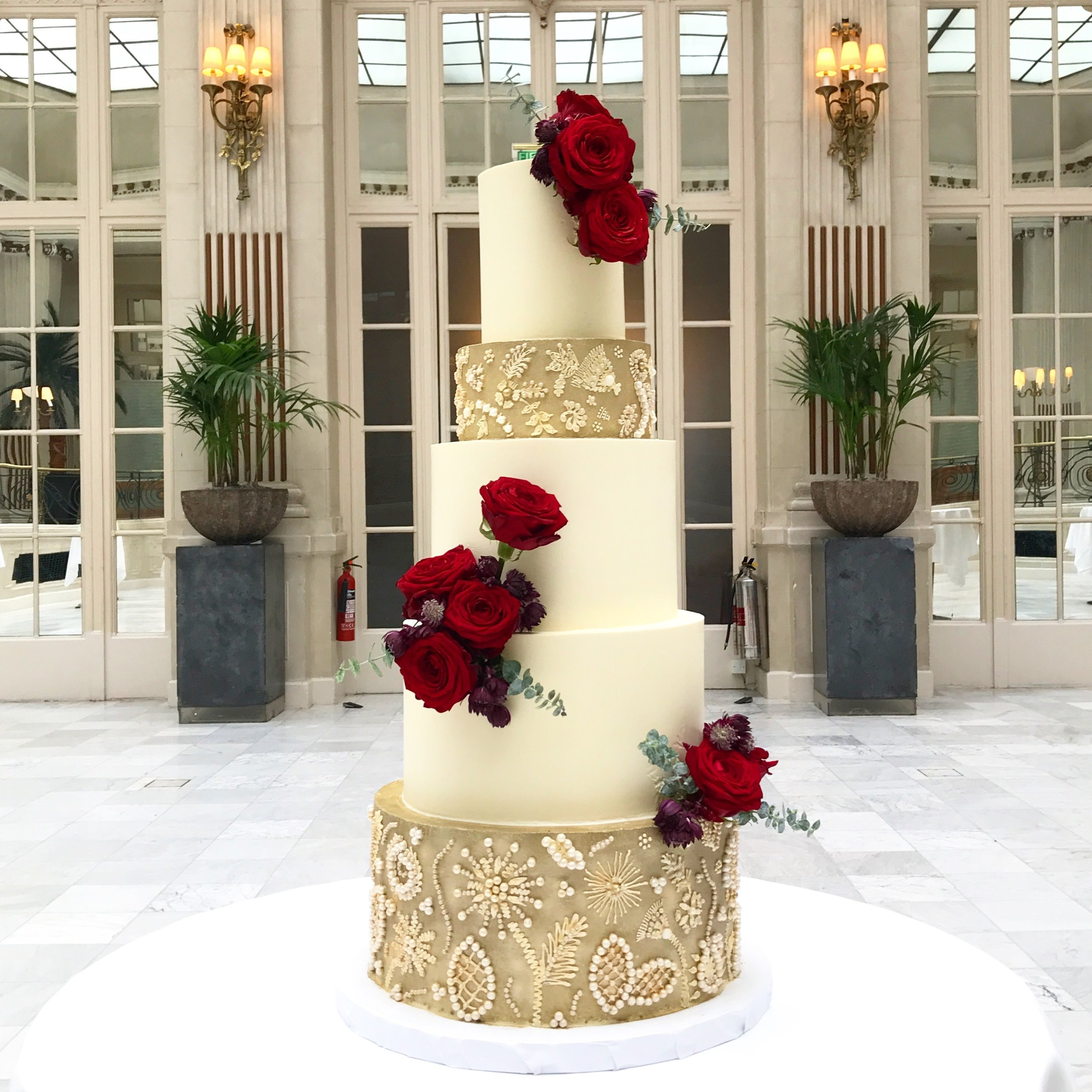 Five tier gold and burgundy buttercream wedding cake.jpeg