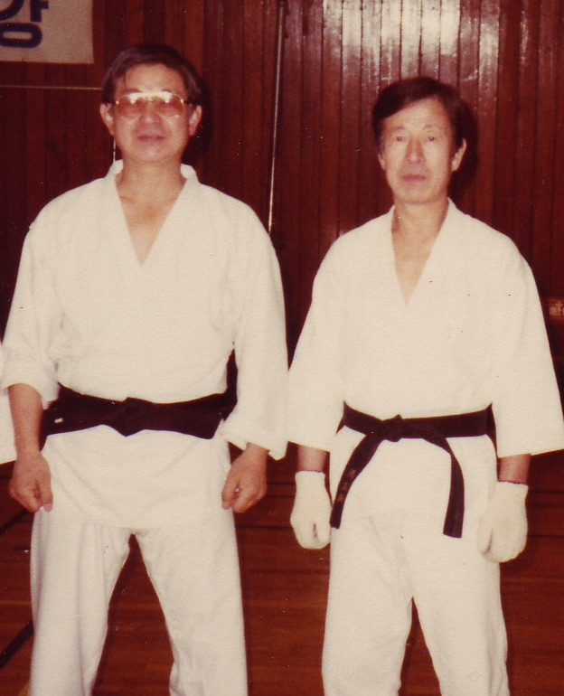Grandmasters Park Chul Hee & Hong Jong Pyo were students of Byung-in Yoon in Korea. This photo was taken in 1983 in Seoul; note the white gloves on Pyo's hands.