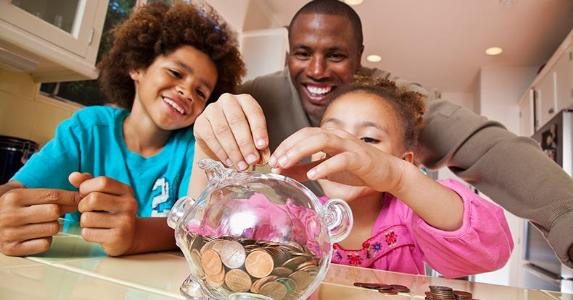 family-showing-young-member-piggy-bank-savings-getty_573x300.jpg