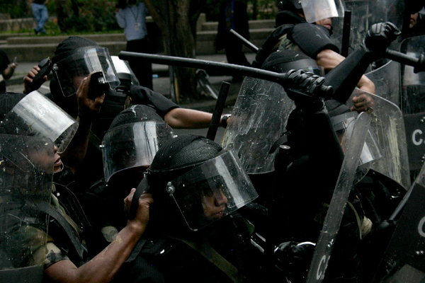 Members of the riot control unit of the Guatemalan National Civilian Police in action during the visit of President George Bush in Guatemala