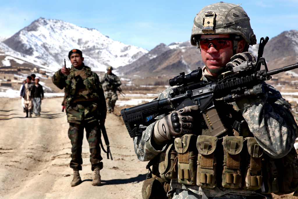 U.S. Army Soldier on patrol with Afghan soldiers in 2010