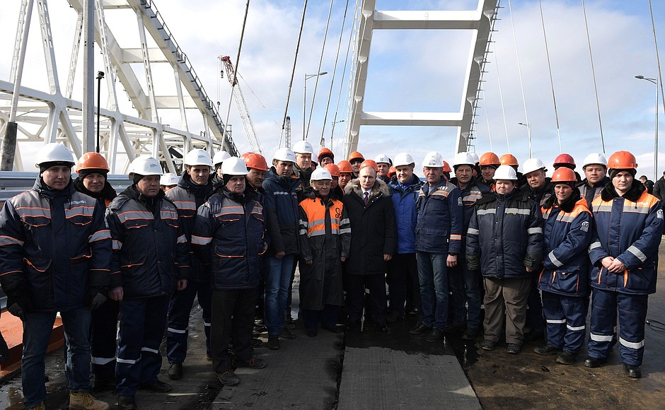 Vladimir Putin meets with the construction workers who recently finished the construction of a bridge connecting Crimea and Russia directly.