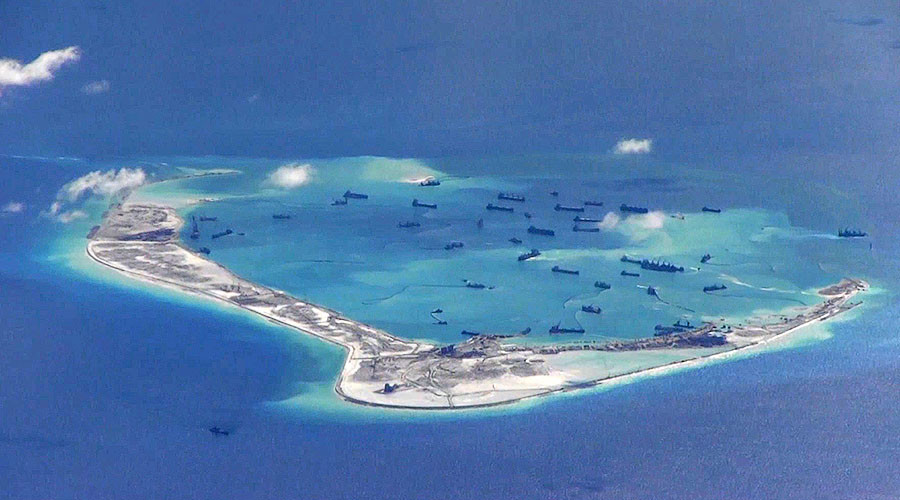 Subi Reef, South China Sea. Chinese dredging vessels are constructing the artificial island, 2015.