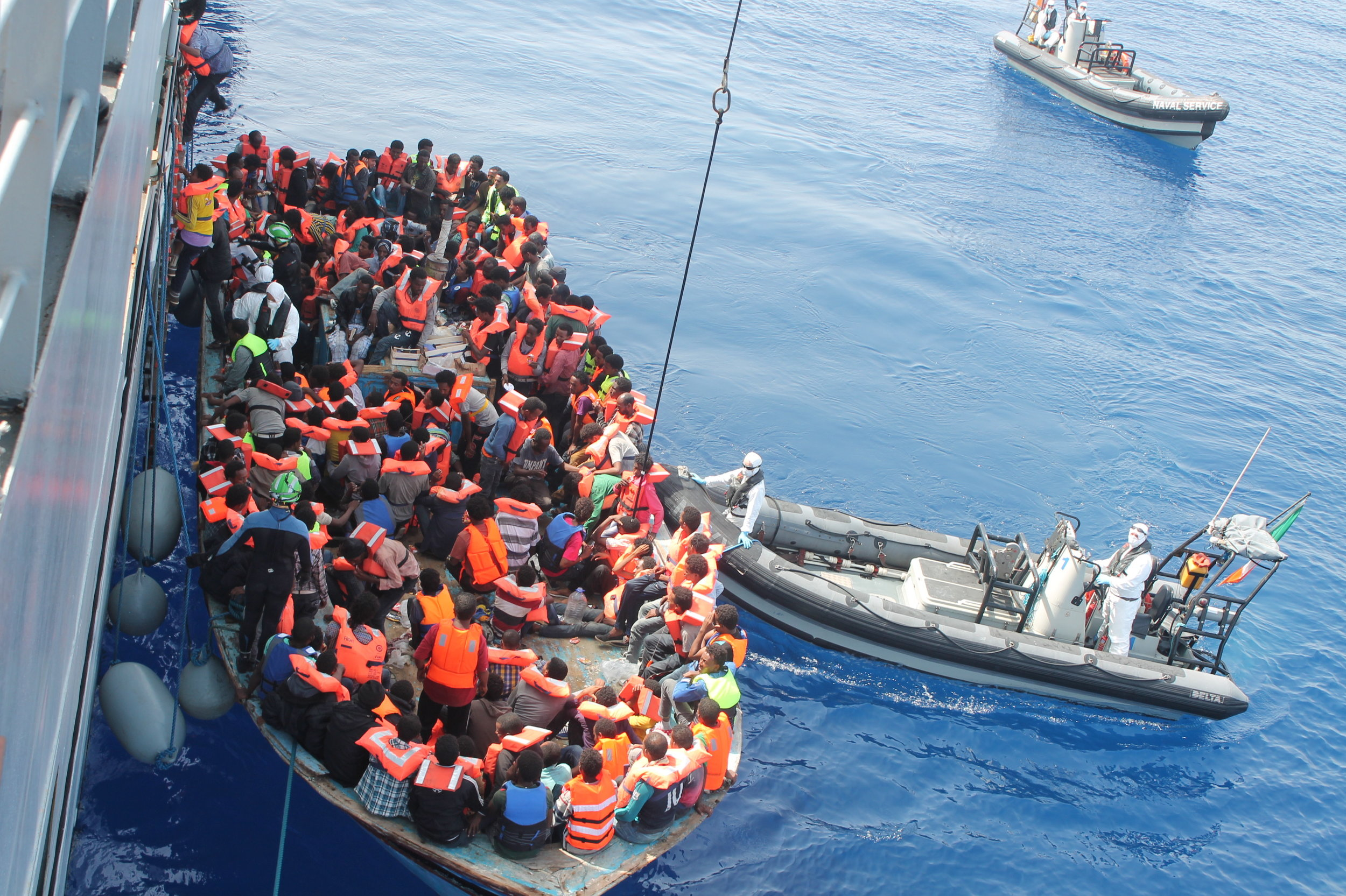 Operation Triton in the Southern Mediterranean. The Irish flagship LÉE Eithne rescues people from a crowded boat, 15 June, 2015.