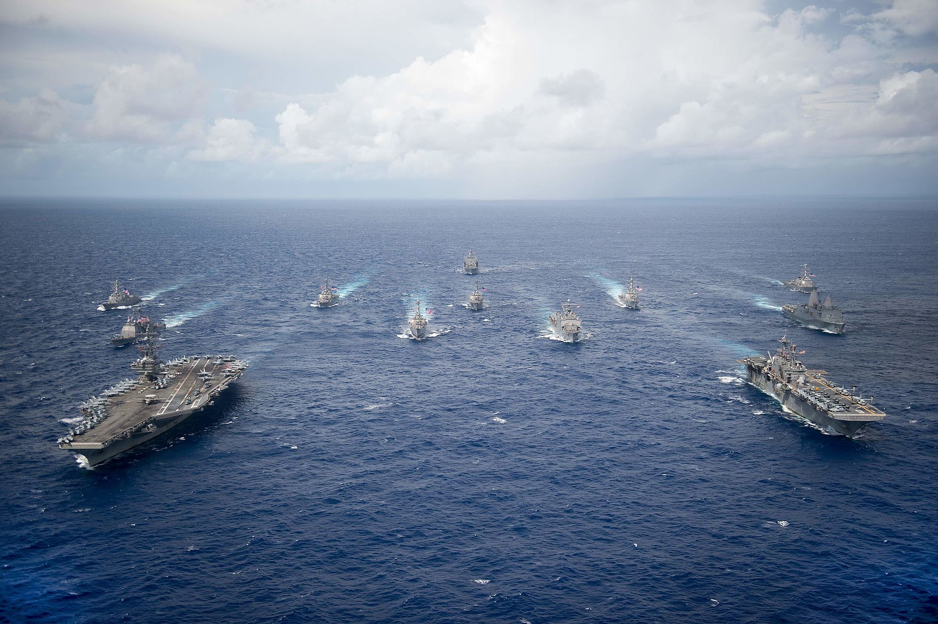 The USS Ronald Reagan and USS Bonhomme Richard lead a formation of Carrier Strike and Expeditionary Strike Group in the South Chin Sea. (Sept. 23, 2016)