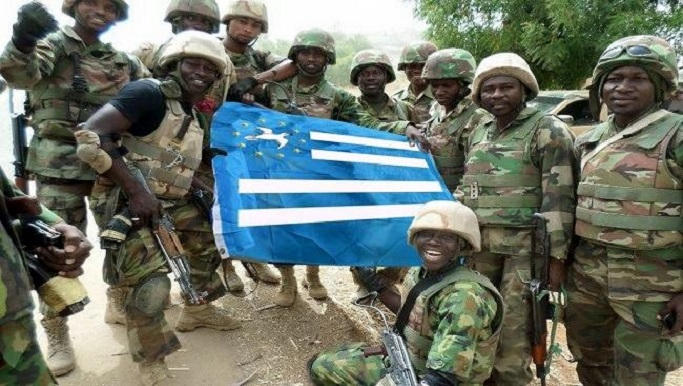 Soldiers holding the Ambazonian flag.