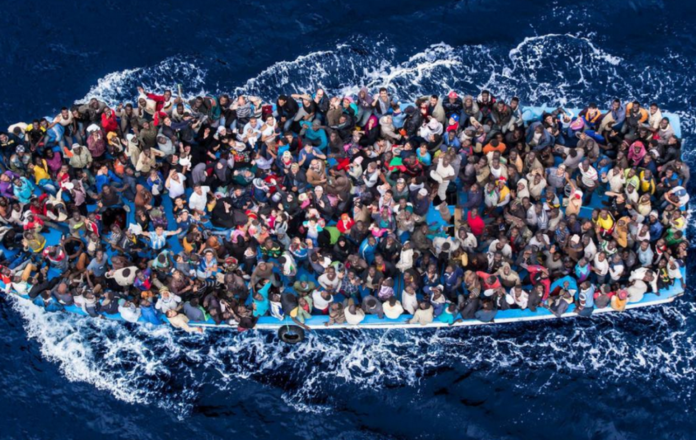 Overhead shot of refugees in a crowded boat