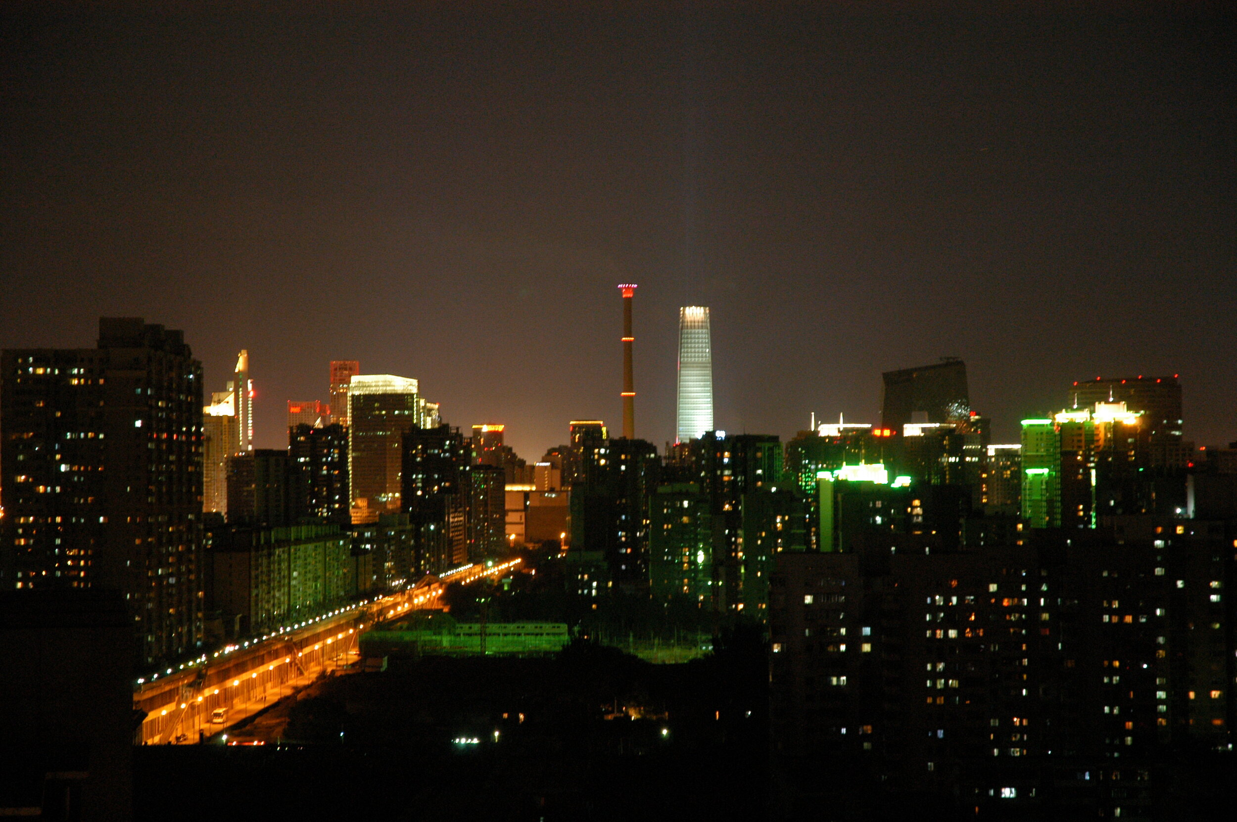 Wikicommons: Beijing central business district skyline at night.