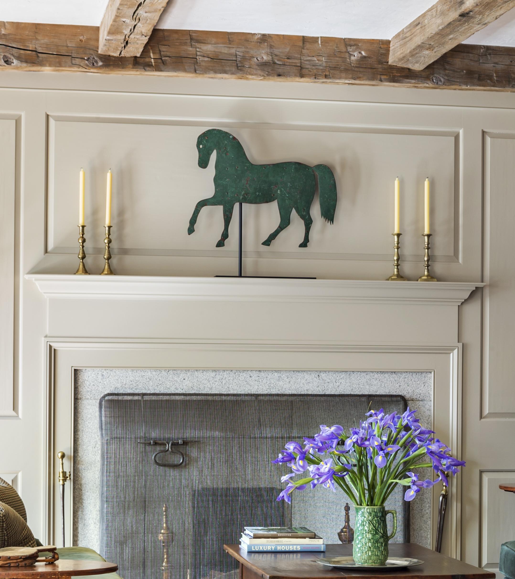 Living Room Fireplace Horse Detail.jpg