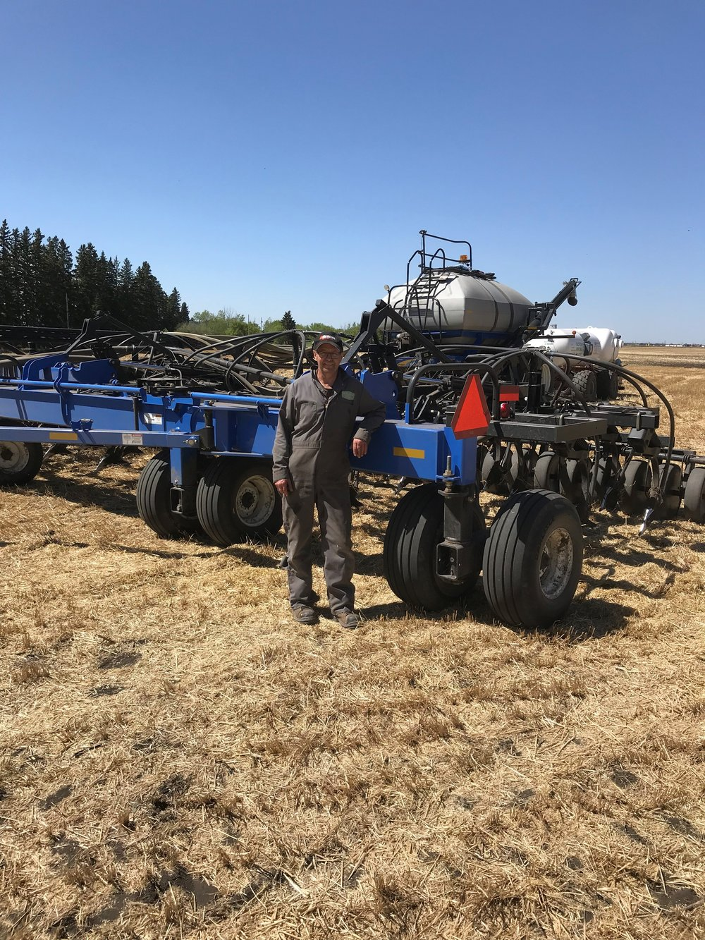 This is the lovely and talented Jim Galloway from Galloway Seeds, poised and ready to get to work planting the 40 acres of canola just south of Fort Sask. on RR 225