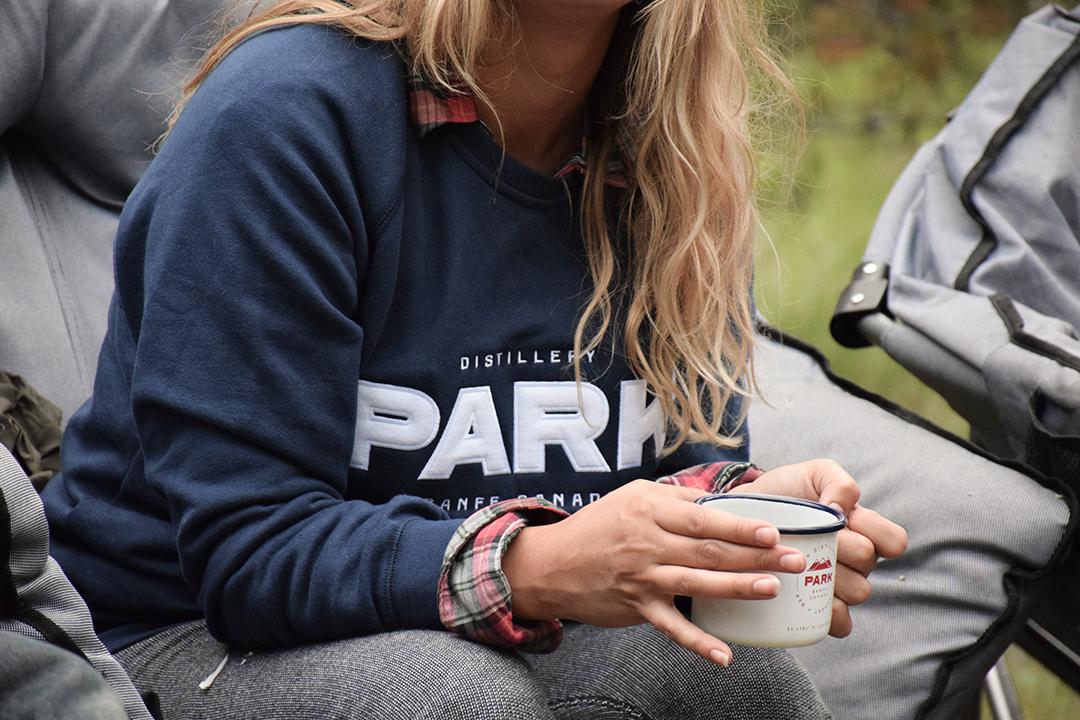 Park Sweater and Mug | Photo Credit: Park Distillery Images