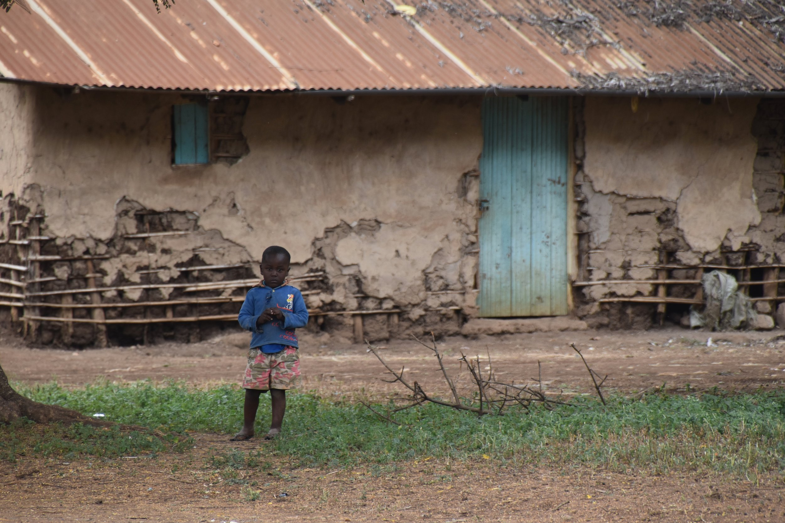 boy in front of house.jpg