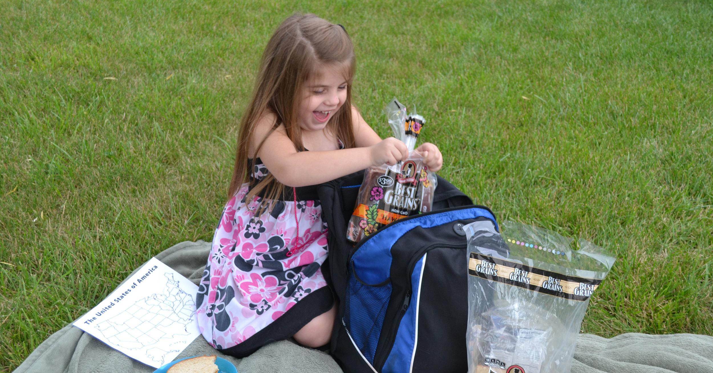 Girl holding Aunt Millie's Best Grains
