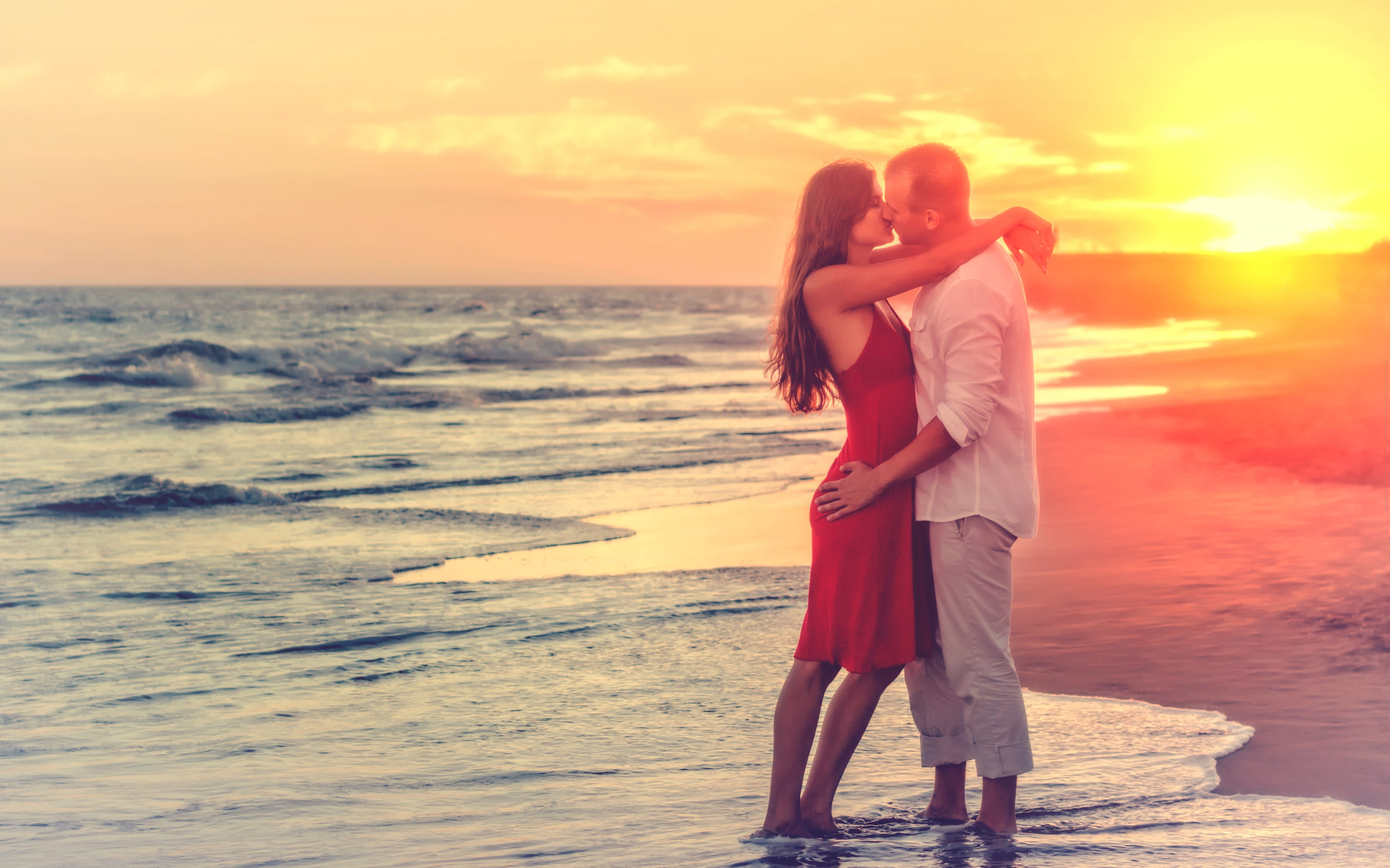 Couple kissing at beach by Jack Moreh, used by permission from  FreeRangeStock . Need to celebrate an anniversary or other special date? Here are 5 ideas to celebrate your anniversary.