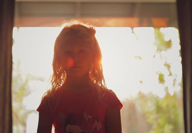 Amalia and window firelight.