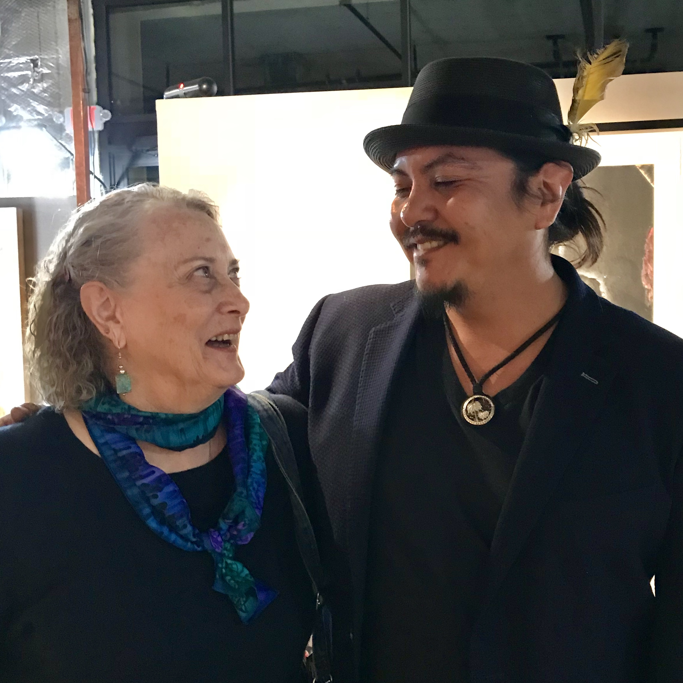 Ira Lujan  and his mom Jan look at each other lovingly.