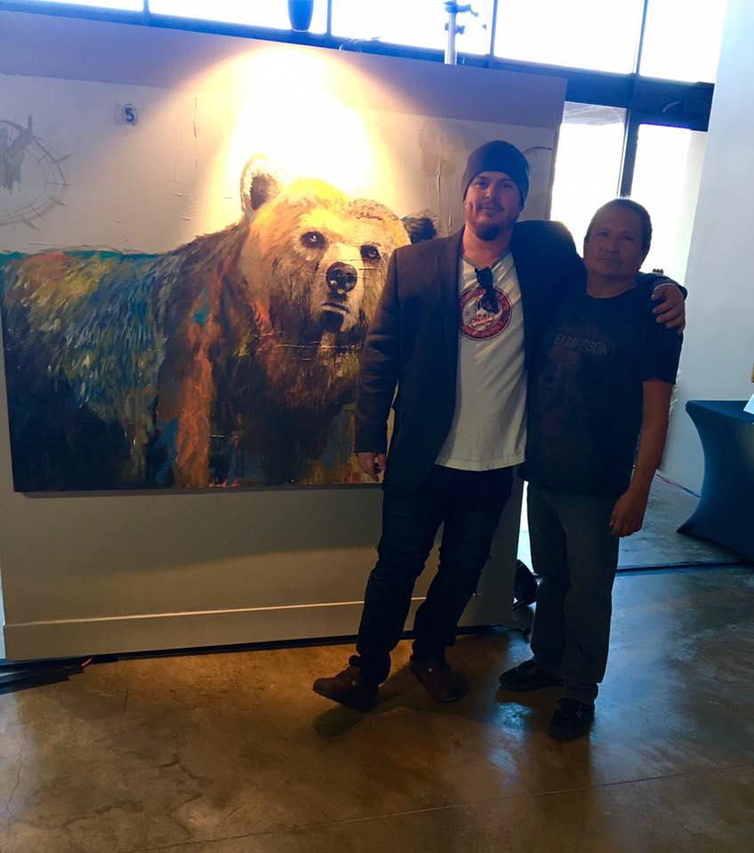 Rhett  stands with artist  Abraham Mojica.
