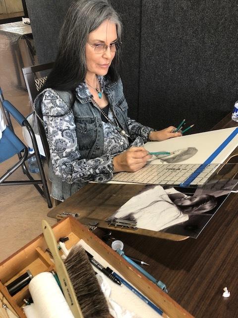 Karen Clarkson  drawing a portrait of Night Zamora.