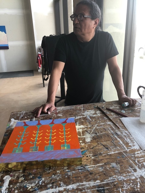Rhett Lynch  working on a painting in his studio.