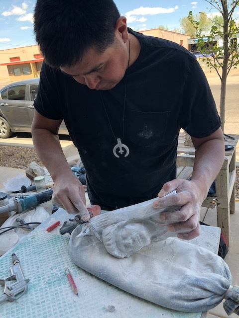 Adrian Wall  sculpting a piece for a collaboration with Ira Lujan and Mateo Romero.