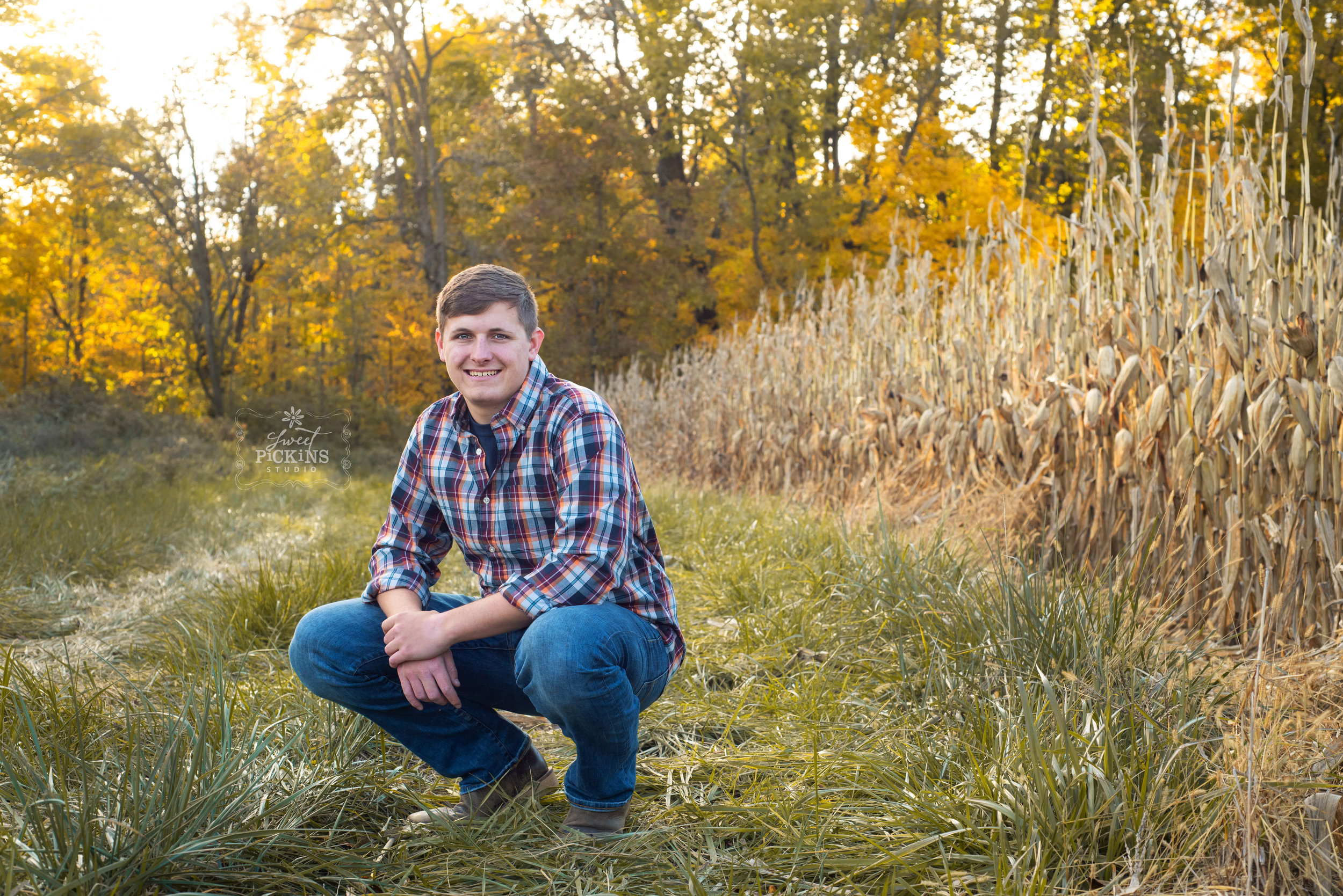 Bunker Hill, IN Senior Portrait Photography | Maconaquah Class of 2019 | Outdoor Fall Senior Farm Boy with Field Corn at Harvest | Flannel and Jeans