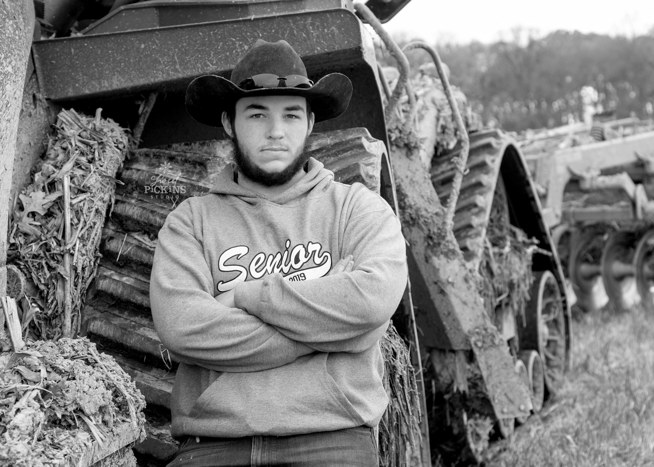 Black and White Senior Portrait with Case IHQuad Track Tractor | Huntington North, Indiana