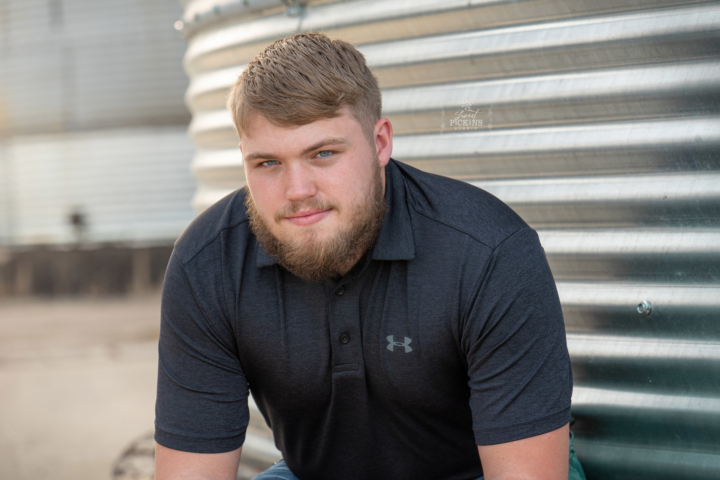 Class of 2019 Senior Guy Photography Session by Sweet Pickins Studio | Farm grain bins in evening light