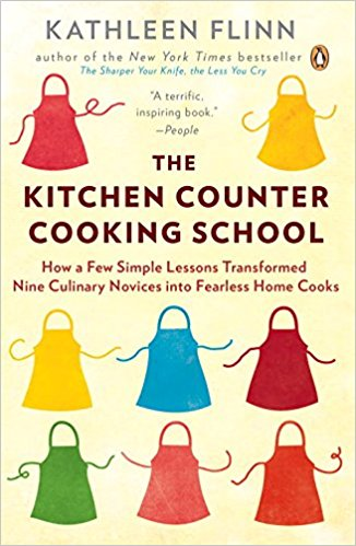 """After graduating from Le Cordon Bleu in Paris, writer Kathleen Flinn returned with no idea what to do next, until one day at a supermarket she watched a woman loading her cart with ultraprocessed foods. Flinn's """"chefternal"""" instinct kicked in: she persuaded the stranger to reload with fresh foods, offering her simple recipes for healthy, easy meals. The Kitchen Counter Cooking School includes practical, healthy tips that boost readers' culinary self-confidence, and strategies to get the most from their grocery dollar, and simple recipes that get readers cooking."""