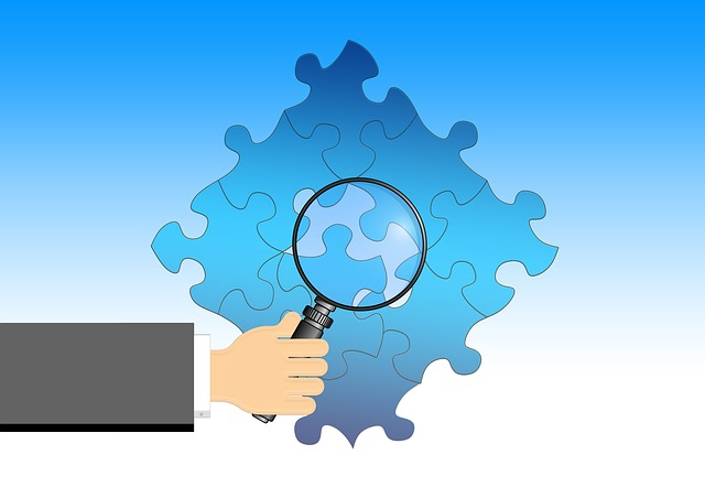 Magnifying glass looking at puzzle.jpg