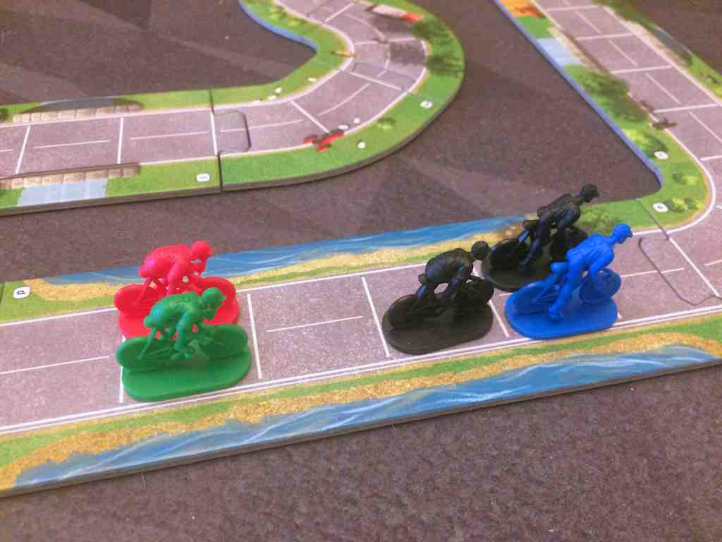 Red and green riders are going to get pulled in by the slipstream.