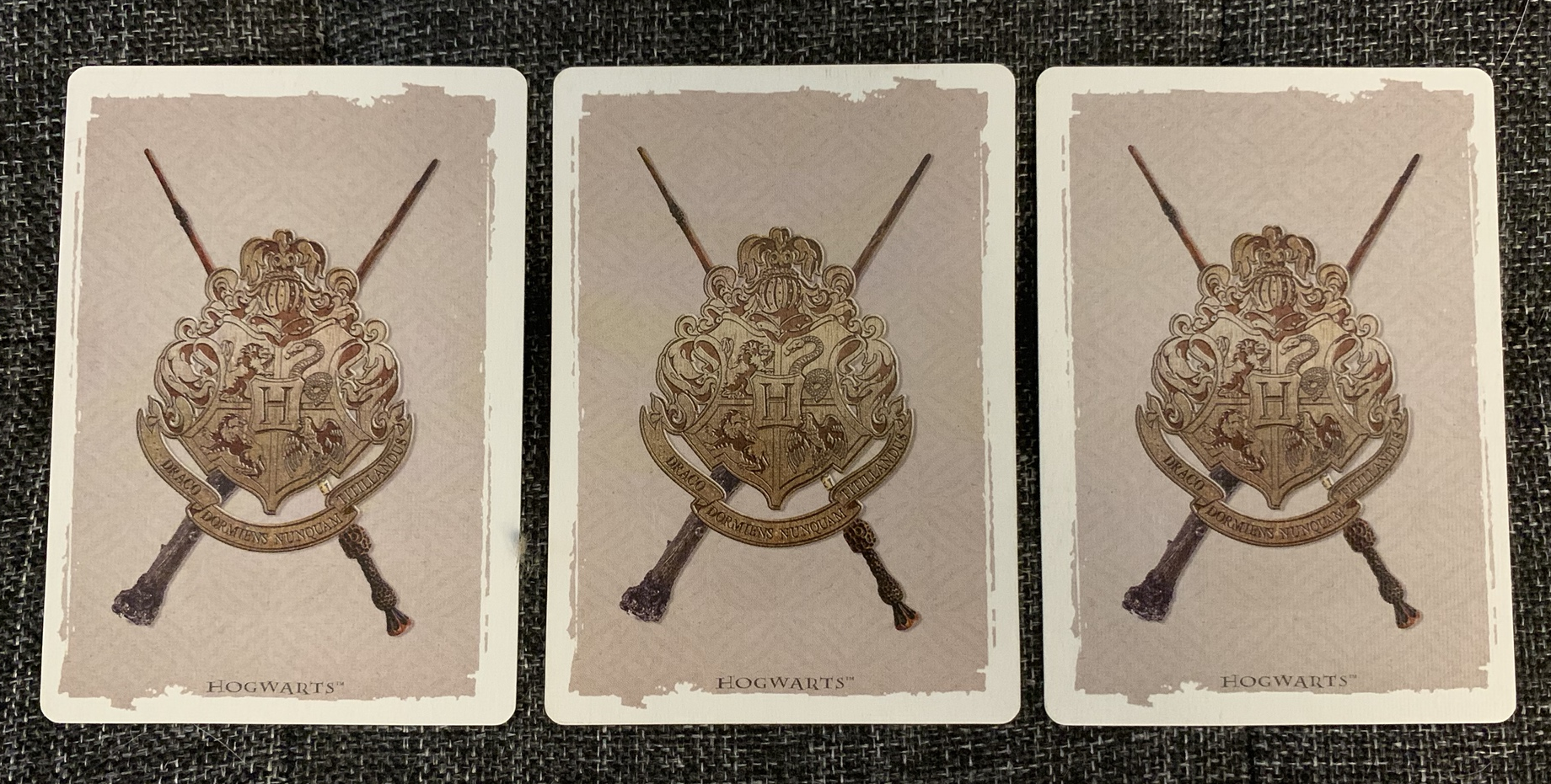 A subtle color difference (the middle card is the odd one out)