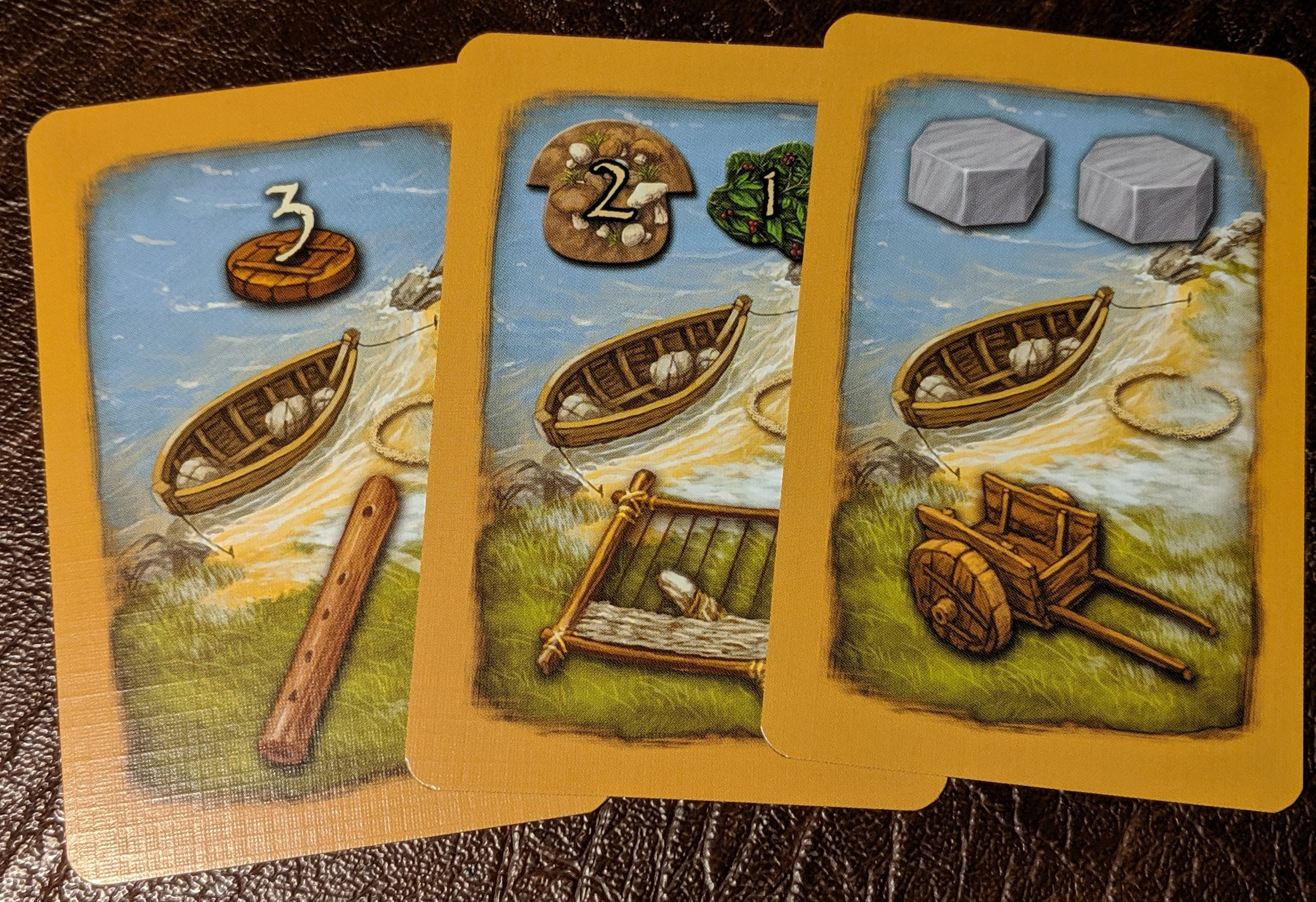 Civilization cards. Immediate bonus on top, with a long term reward for collecting the unique symbols.