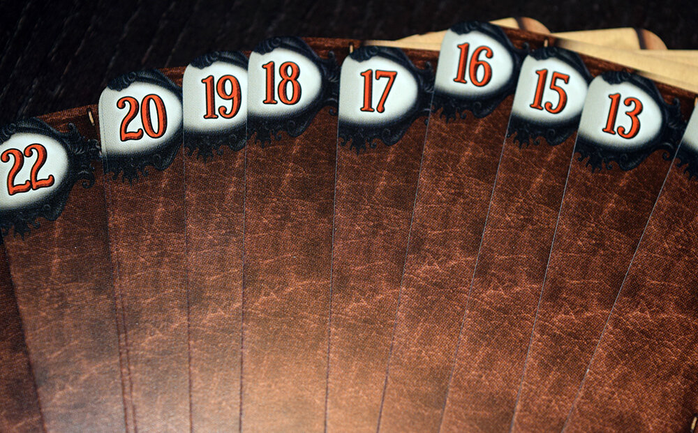 Each card has a number on the back of it. To reset the game just put all card back in numerical order.