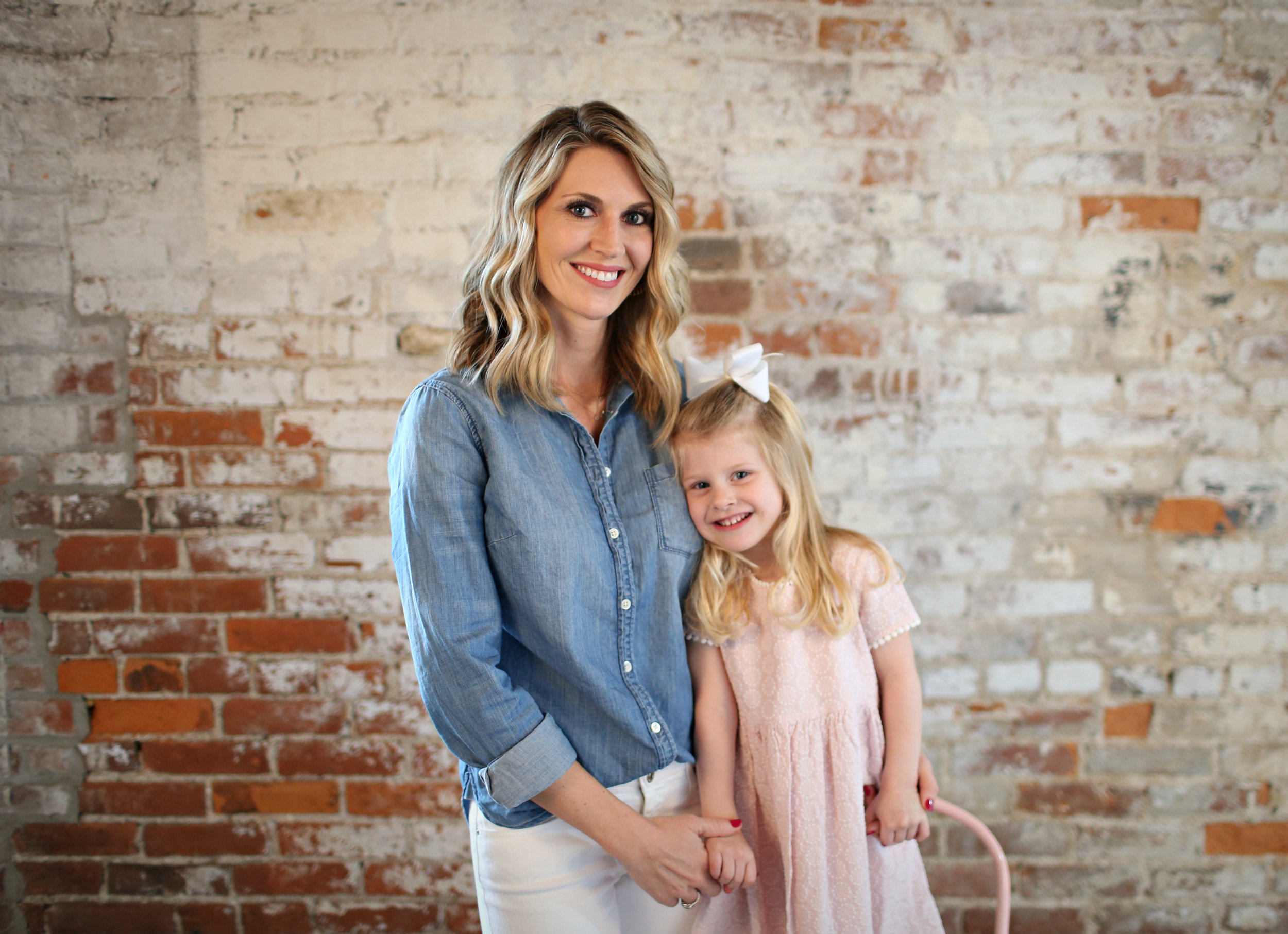 Fashion blogger, Lady and Red with daughter R posing for a photo in front of an old brick wall background | LadyandRed.com