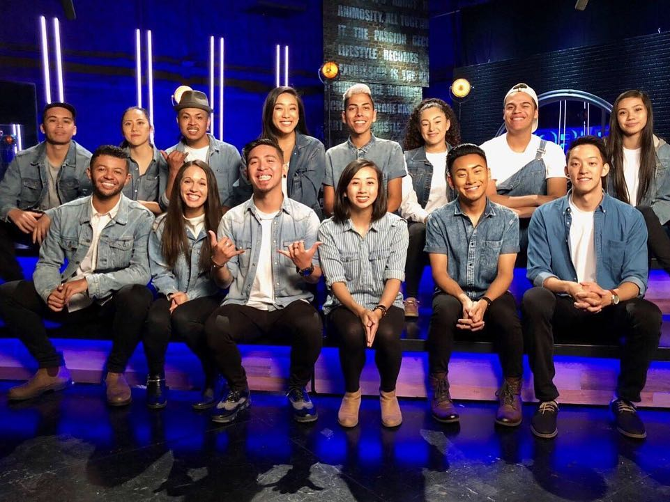Merrill, bottom row, second from the left, backstage with her hip hop team Str8Jacket at World of Dance Season 3 on NBC.