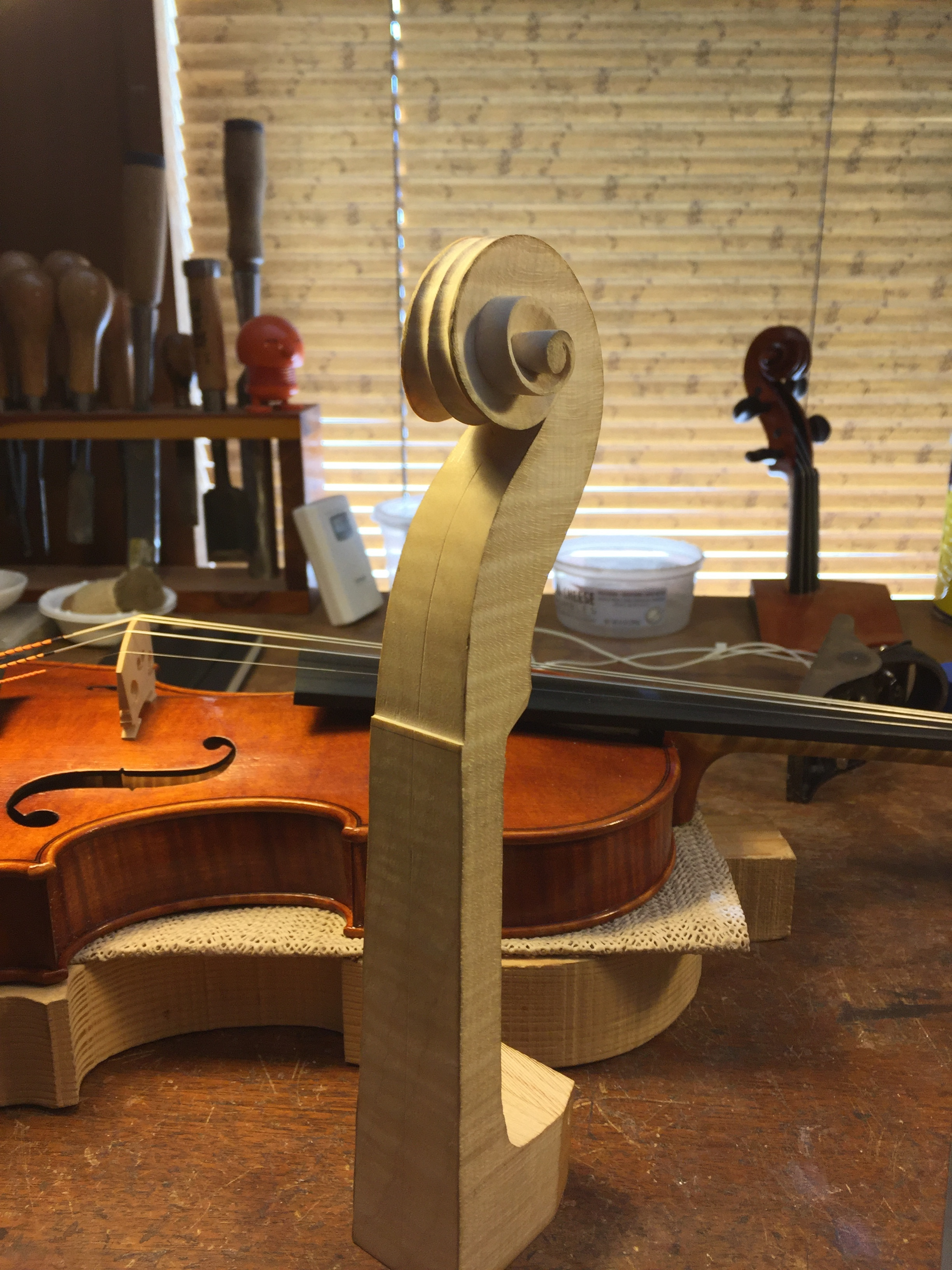 Finished violin scroll volute