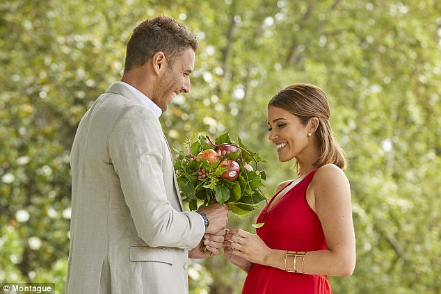 Upswing: The formally dressed pair were pictured celebrating the presence of an apple bouquet from brand Montague.