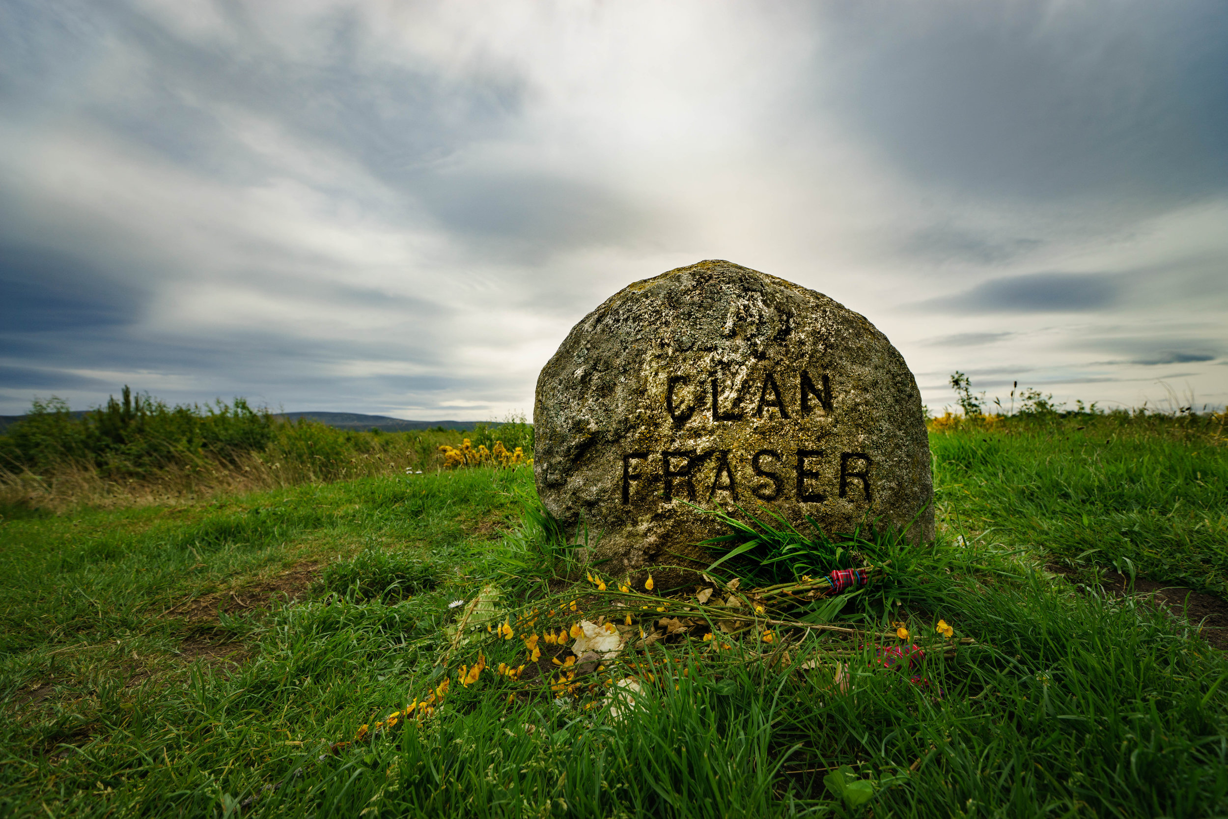 """One of many clan headstones placed in the 1880's by Duncan Forbes. Because of the popular Starz TV drama """"Outlander"""" and it's fictional lead character Jamie Fraser, this marker is often surrounded by visitors to the extent of complaints other clans are being ignored."""