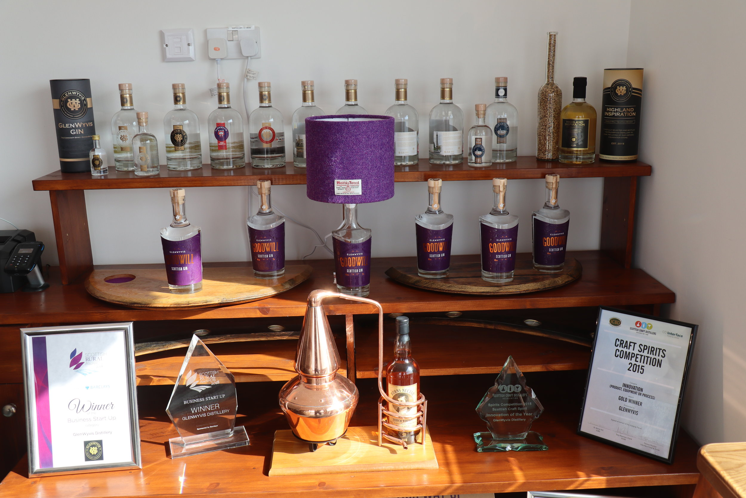 This wee display of awards and product, old and new, is what presently amounts to a visitor center at GlenWyvis.