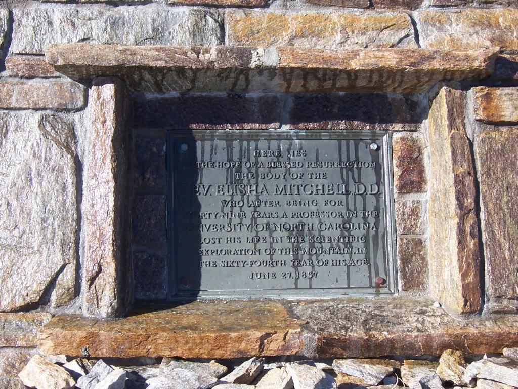 Elisha Mitchell is buried at the Reverend Elisha Mitchell Gravesite on the peak of Mount Mitchell, North Carolina.