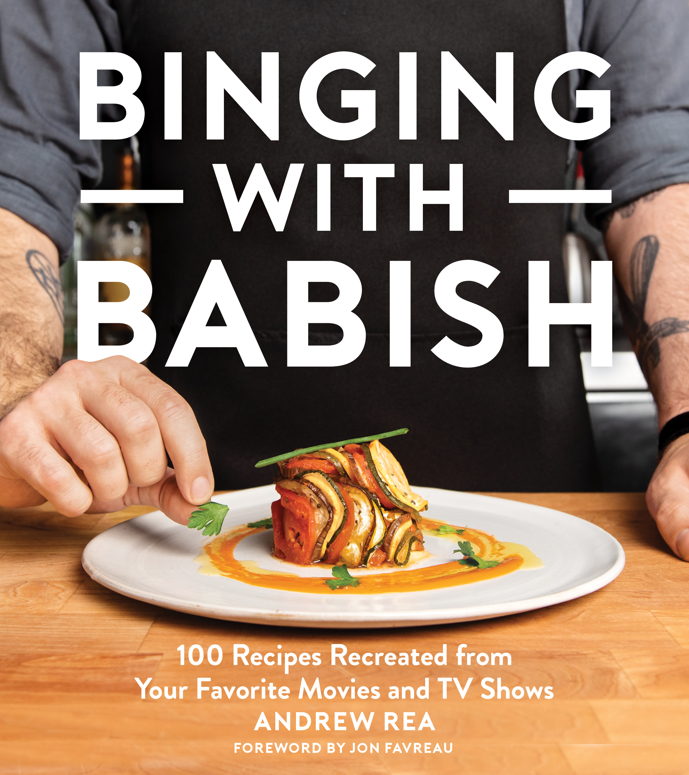 IT'S TIME - Well, it was bound to happen. With so much food being prepared, experimented upon, and (usually) eaten, it was inevitable that one fine day, I'd write down some recipes. But I've done that and so much more with the first 100 recipes featured in the official Binging with Babish Cookbook - take a look behind the scenes, see some goofy (and mouthwatering) photos, hear some happy and sad stories, and read a touching foreword by the man himself, Jon Favreau. Preorder your copy now for some juicy bonus content before the book drops on October 22nd!