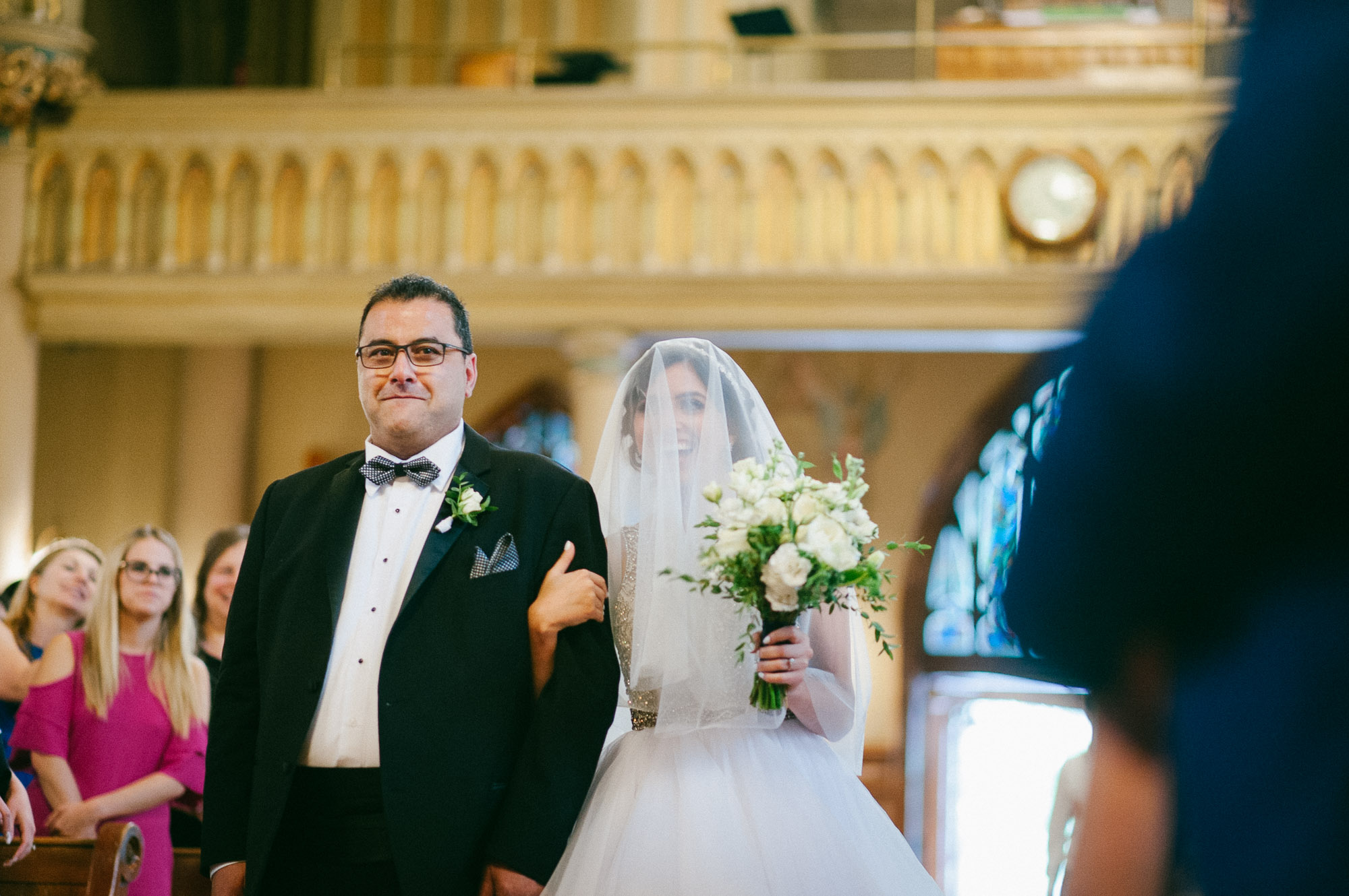 bride-walking-down-aisle-in-church