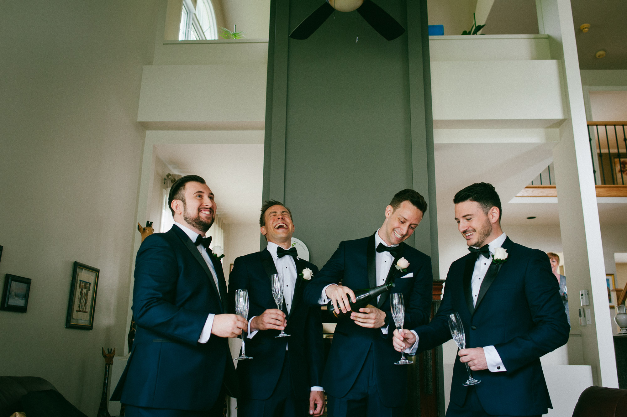 groomsmen-celebrating-with-champagne