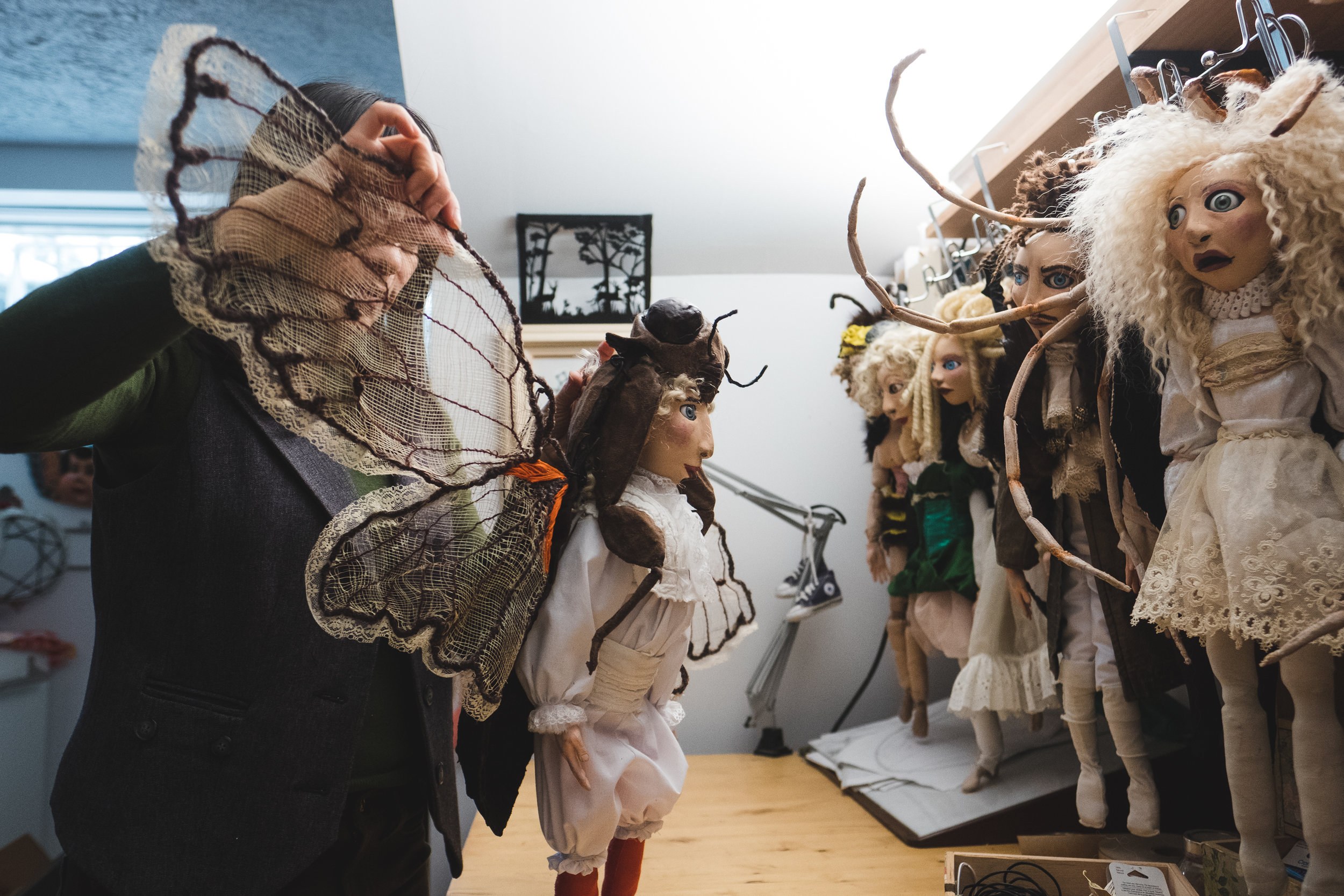 mirna-rivera-with-insect-puppets