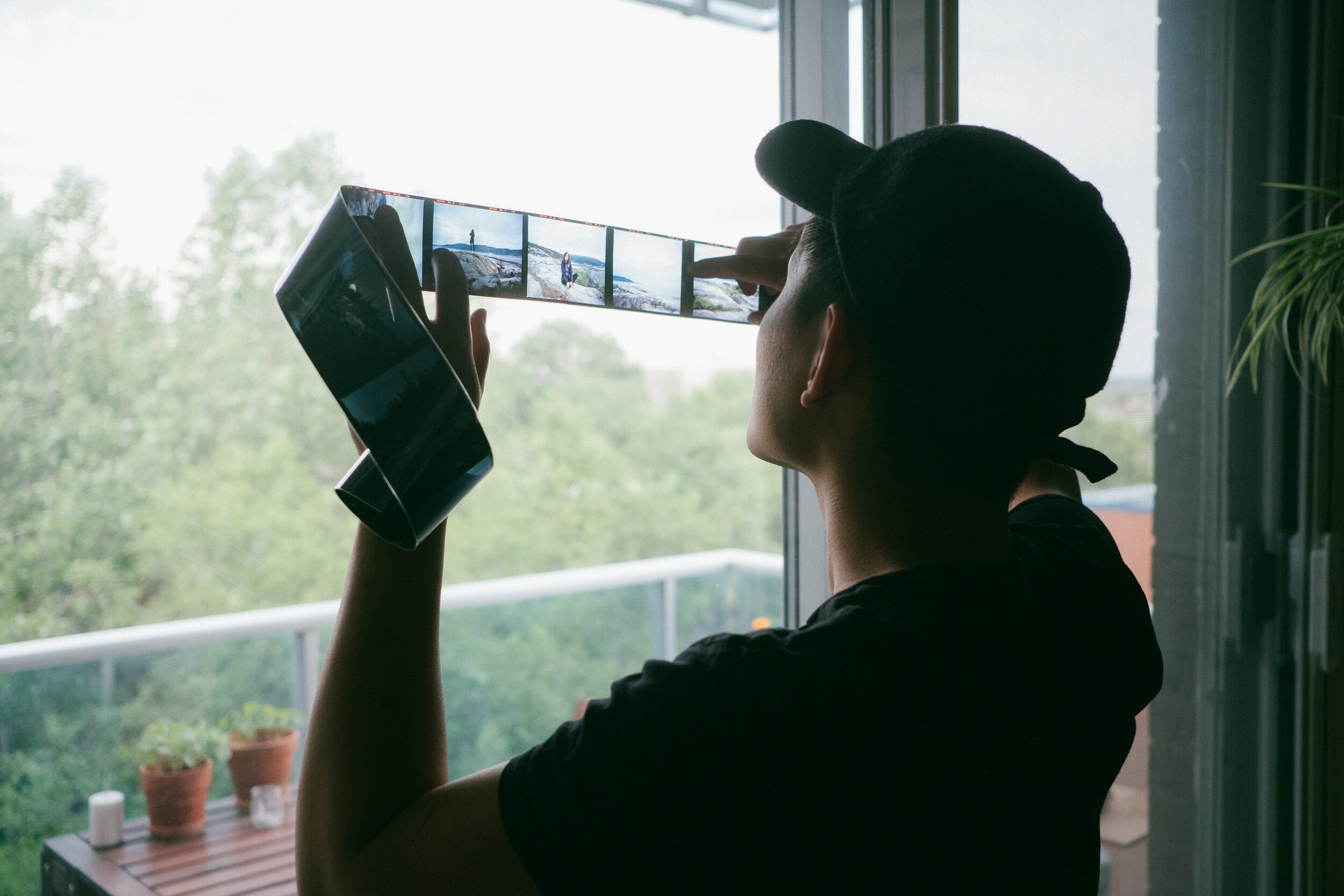 photo-of-photographer-alex-tran-looking-at-slide-film