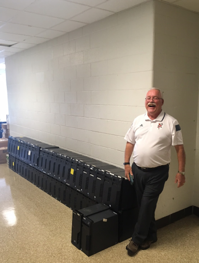Scott Horan with computers ready to be picked up
