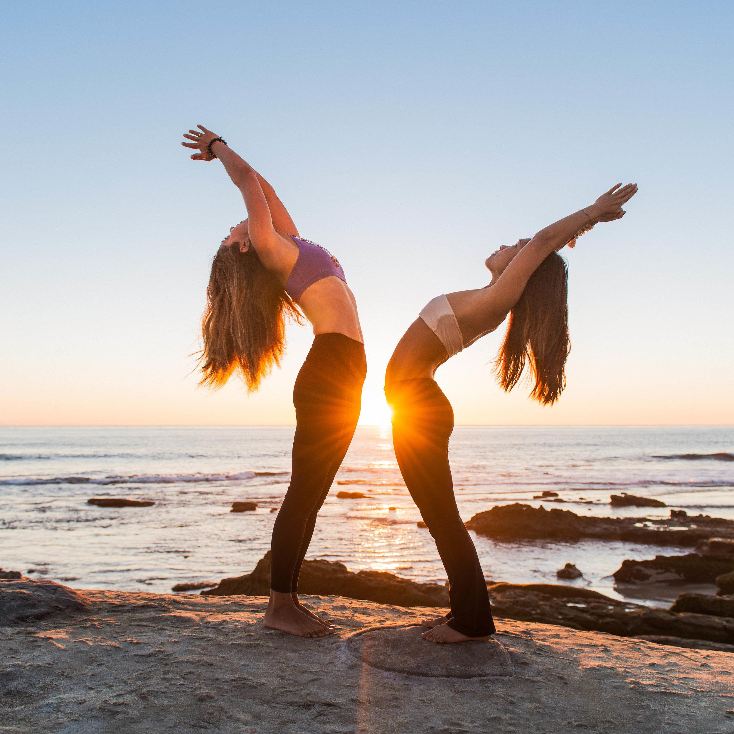 two-women-yoga-retreat-beach.jpg