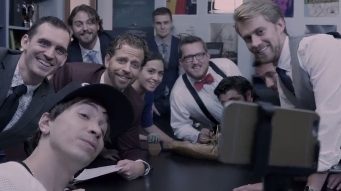 Jacob (Center) in a still from The Real Stephen Blatt, with Justin Long (front left) and other Asolo Conservatory alums (L-R): Rob Glauz, Brandon Maldonado, Tony Stopperan, Danielle Renella, Jon-Michael, Jacob, Wyatt McNeil, and Mike Fisher (behind Wyatt).